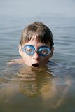 Taking breath. Boy taking breath before diving into water Royalty Free Stock Photo