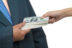 Taking bribe. Close up of a male�s hand taking bribe stock photos