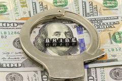 Taking a bribe. In dollars Royalty Free Stock Images