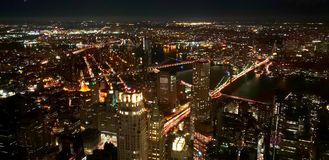 NYC MANHATAN BLOOKLYNG BRIDGE LIGHTS. TAKING THE BROOKLYN BRIDGE FROM THE ONE WORLD TRADE CENTER OBSERVATORY IN MANHATTAN stock image