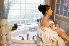 Taking a bubble bath Royalty Free Stock Image