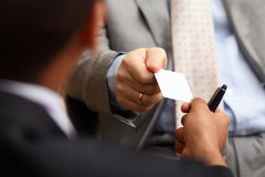 Taking businesscard. Closeup portrait of two successful business executive exchanging business card Royalty Free Stock Photos