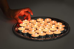 Taking a candle Stock Photography
