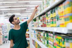 Taking canned food Stock Images