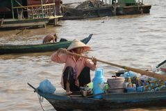 Taking a canoe is part of daily life on the Tonle Sap stock photo