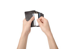 Taking a card out of a wallet Stock Photo