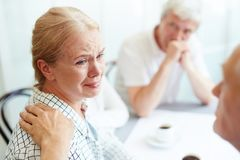 Taking care of crying friend royalty free stock photo