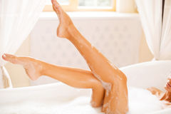 Taking care of her beautiful legs. stock images