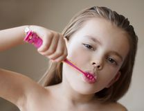 Taking care of her teeth from a young age royalty free stock photos