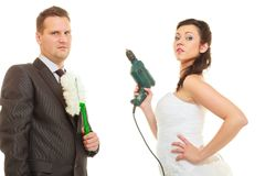 Bride and groom sharing household duties stock photos