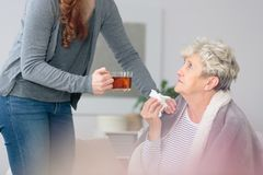Taking care of ill grandmother Stock Photo