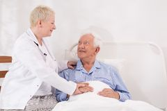 Taking care of old man. Doctor is taking care of old man stock images