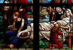 Taking care of a sick person. A stained glass photo of the care of a sick person Royalty Free Stock Photo