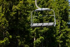 Taking chair lift after long walk Stock Image