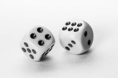 Taking Chances. A pair of dice in motion captured in a shallow Depth-of-Field is used to portray the act of taking chances Stock Images