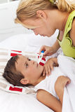 Taking child's temperature Royalty Free Stock Image