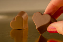 Taking a chocolate heart Royalty Free Stock Photo