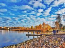 Taking in the city lake. Töölönlahti in Helsinki, Finland is a beautiful location. Near the city but such beautiful nature scenes in autumn. A nice blue sky royalty free stock images