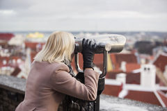 Taking a city view by binoculars Royalty Free Stock Photos
