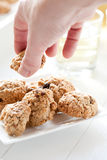 Taking a cookie Royalty Free Stock Photo