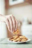Taking cookie Stock Photos