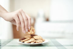 Taking cookie Royalty Free Stock Image