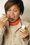 Taking cough medicine stock photos