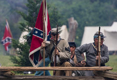 Taking Cover. Civil War era soldiers in battle at the Dog Island reenactment in Red Bluff, California stock image