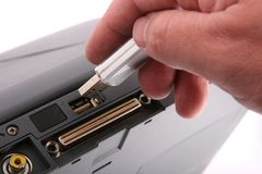 Taking data off a laptop. Plugging in USB data device to the back of a laptop Royalty Free Stock Photo