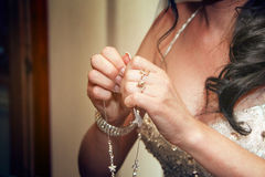 Taking diamond necklace Royalty Free Stock Images