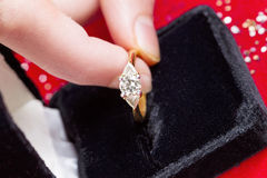 Taking Diamond Ring out of Jewelry Box Stock Photography