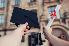 Taking diploma in hand. royalty free stock photos