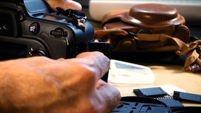 Taking DSLR camera from the table stock video