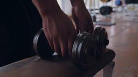 Taking dumbbells (hands only) stock video