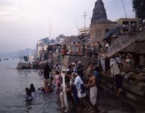 BANARAS: Early morning bath in the Ganges at Banaras. Taking an early morning dip in the Ganges. Samsara literally means `wandering on` the endless stream of royalty free stock photos