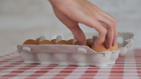 Taking egg from package. Men`s hand taking egg from cardboard package stock video