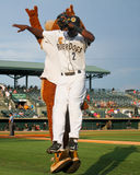 Taking the field. Charleston RiverDogs mascot Charlie high fives Jorge Mateo as he takes the field to start the game Royalty Free Stock Photography