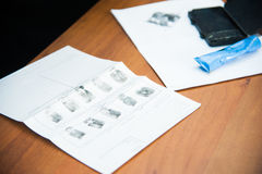 Taking fingerprints. The investigation of the crime. The inspector takes fingerprints of a suspect Stock Photo
