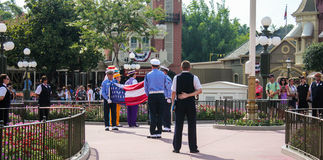 Taking the flag down at Magic Kingdon, Orlando, FL. Royalty Free Stock Photography