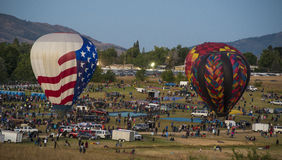 Taking Flight. 2 hot air balloons prepare to take flight at the balloon races in Reno Nevada Royalty Free Stock Photography