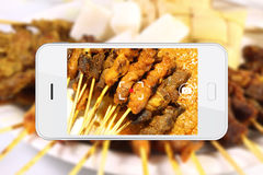 Taking food photo with smartphone. Royalty Free Stock Images