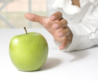 Taking a fresh green apple Royalty Free Stock Photography
