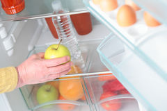 Taking Fruit from Fridge Royalty Free Stock Photography