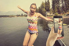 Taking fun photos on your smartphone at the lake Royalty Free Stock Photography