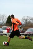 Taking a Goal Kick. A goal keeper takes a goal kick in a game of football stock photography