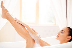 Taking good care of her skin. Royalty Free Stock Image