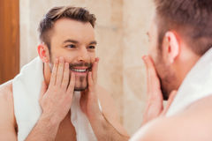 Taking good care of his face. royalty free stock photo