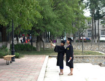 Taking graduation photos Royalty Free Stock Image
