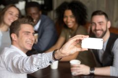 Taking group selfie concept, multiracial friends making photo on Royalty Free Stock Images