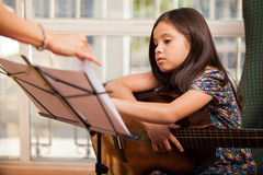 Taking guitar lessons Stock Photo